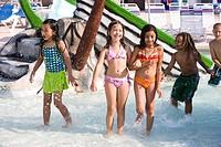Multi_ethnic children at water park in summer