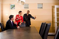 Multi_ethnic businesspeople in boardroom