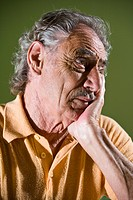Close_up of depressed senior man thinking