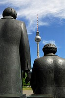 Berlin  Germany  Staue of Karl Marx right &amp; Friedrich Engels on Marx-Engels-Forum, facing the Furnsehturm TV tower on Alexanderplatz