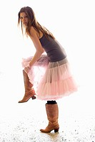 Young woman pink skirt cowboy boots