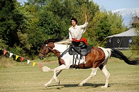 Participants demonstrating traditional equestrian games for the audience, open Eocha European championship 09, mounted archery, with steppe riders fro...
