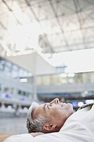 Businessman relaxing in airport terminal