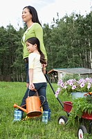 Mother gardening with daughter
