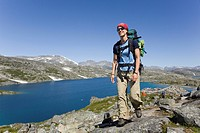 Young woman, hiker with backpack, hiking, historic Chilkoot Pass, Chilkoot Trail, Crater Lake behind, alpine tundra, Yukon Territory, British Columbia...