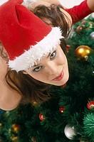 Girl at the christmas tree