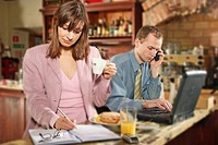 Couple with food while working