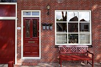 Red brick house with red bench and doors, Edam, Holland, Netherlands, Europe