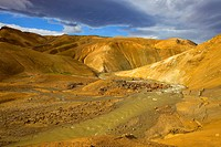 Geothermal area Kerlingarfjoell, hills coloured by minerals and colorful rhyolite mountains underneath the Kerlingarfjoell glacier, streams, Iceland, ...