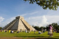 Tourists viewing El Castillo Pyramid of Kukulcan 'The Castle' during the fall equinox at the Mayan site of Chichen Itza, Mexico