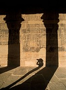 Shadow of woman taking photographs, Temple of Isis, Philae Island near Aswan, Egypt