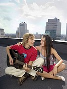 Couple with guitar on the roof