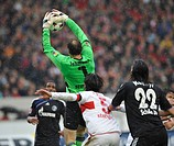 Goalkeeper Jens Lehmann, VfB Stuttgart, catching a ball in front of Kevin Kuranyi, Schalke 04, with Serdar Tasci, VfB Stuttgart, in the middle