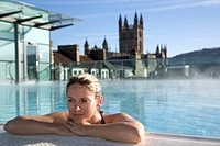 Young woman relaxing in roof top pool, Thermae Bath Spa, Bath,England