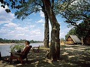 Tourist and lodge, safari, Luwanga Valley National Park, Zambia