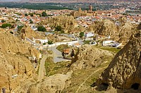 Cave-houses at Santiago troglodyte quarter and the Alcazaba at back, Guadix, Marquesado region, Granada province, Andalusia, Spain, Europe