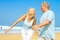 Senior couple having fun at a beach on a beautiful summer day