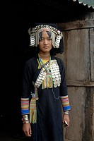 Portrait, ethnology, woman of the Akha Pixor ethnic group in traditional dress, hood as a headdress, many silver coins as jewellery, village Ban Moxox...