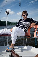 Man resting on the sailing boat