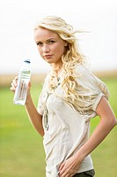 Young woman holding a water bottle