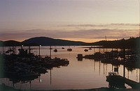 Photograph of a small harbor in Alska at sunset