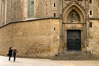 Two women talking in front of Basilica de Santa Maria del Mar church in La Ribera district Barcelona Spain Europe