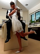 Newlyweds in a kitchen
