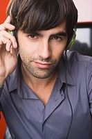 Portrait of a man listening to headphones