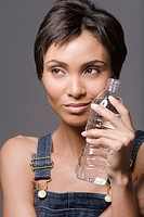 Close_up of a woman holding a water bottle