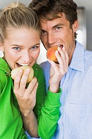 Close_up of a couple eating fruits