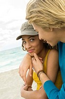 Teenage boy with a girl romancing on the beach (thumbnail)