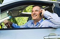 Man in a car and talking on a mobile phone (thumbnail)