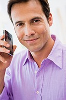 Portrait of a man talking on a mobile phone (thumbnail)