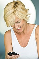 Woman text messaging and smiling