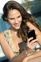 Woman reading text message on a mobile phone