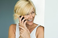 Woman talking on a mobile phone and laughing