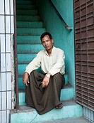 Man sitting on steps, Myanmar