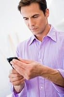 Man text messaging