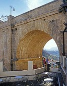 Rondas New Bridge that divides the old and new towns with family on terrace looking outwards The Puente Nuevo is over 200 years old It is the tallest ...