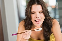 Close_up of a woman eating sushi