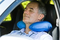 Man sleeping in a car