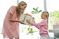 Girl giving present to her mother