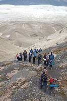 People hike towards Root Glacier in Wrangell-St. Elias National Park, where they will learn ice climbing, Kennicott, Alaska, USA