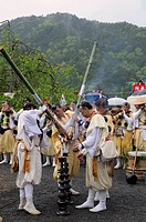 Yamabushi, mountain ascetics, Buddhist sect igniting bamboo torches for the sacred cedar fire, Iwakura, Japan, East Asia, Asia