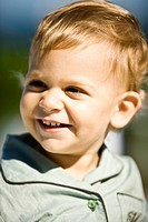 Close_up of a baby boy smiling