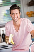 Portrait of a man eating a banana