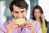 Man eating a pineapple slice