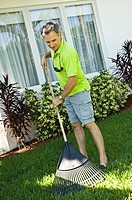 Man raking the lawn