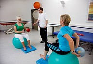 Physiotherapy exercises using exercise balls, physical therapy in a neurological rehabilitation centre, Bonn, North Rhine-Westphalia, Germany, Europe