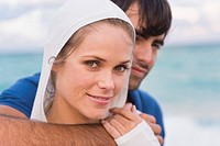 Couple smiling on the beach (thumbnail)